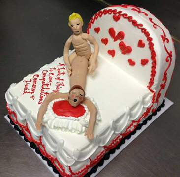 gay and blonde riding his partner on their gay bed cake.jpg